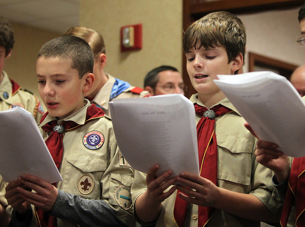 Peabody: Stephen Hansen and Mason Moreschi of Troop 19 of Middleton sing Christmas Carols to residents at Brooksby Village on Tuesday afternoon. DAVID LE/Staff Photo