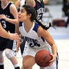 Ken Yuszkus/Staff photo: Danvers: Danvers' Valentina Gigli looks for the basket as Swampscott's Hannah Leahy tries to block during the Swampscott at Danvers girls basketball game.