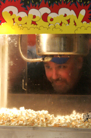 Ken Yuszkus/Staff photo: Beverly: Beverly Boys Basketball Booster member Mike Anderson makes popcorn at the start of the Beverly Invitational boys basketball games at Beverly High School.
