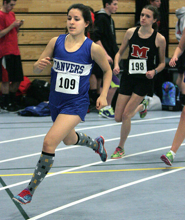 Ken Yuszkus/Staff photo: Danvers: Danvers' Catalina Dominick leads the runners at the start of the mile race at the Marblehead at Danvers indoor track meet.