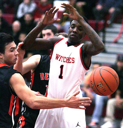 Ken Yuszkus/Staff photo: Salem:<br /> Salem's Rashad Keys, right, loses the ball as Beverly's Jonathan Berchoff reaches for it during the Beverly at Salem boys basketball game.