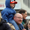 Beverly: Michael Barry, 4, has a great view of the 66th annual Beverly Holiday Parade on the shoulders of his father, Michael, on Sunday afternoon. David Le/Salem News