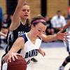 Ken Yuszkus/Staff photo: Danvers: Danvers' Emily McNulty turns before firing for the hoop as Swampscott's Hannah Leahy reaches to block during the Swampscott at Danvers girls basketball game.