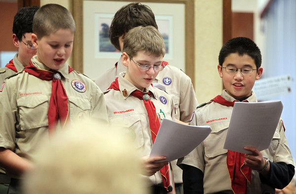Peabody: Andrew Hansen, Christopher Stankus, and Justin Chang, of Troop 19 of Middleton sing Christmas Carols to residents at Brooksby Village on Tuesday afternoon. DAVID LE/Staff Photo