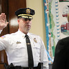 Beverly: Beverly Police Chief John LeLacheur is sworn into office by City Clerk Kathleen Connolly in the City Council chambers at Beverly City Hall on Thursday afternoon. DAVID LE/Staff Photo