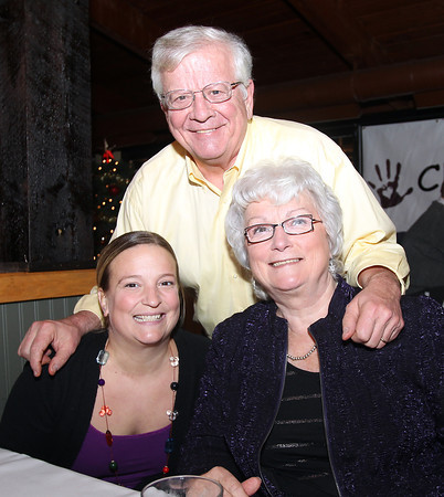 Salem: Amy Muzarol, with her parents Ed and Carol Potvin at the 20th annual Salem Children's Charity party held at Victoria's Station in Salem on Tuesday evening. DAVID LE/Staff Photo