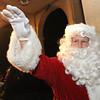 Ken Yuszkus/Staff photo. Salem: Santa waves to the crowd at the tree lighting in Salem Common.