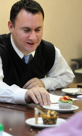 Ken Yuszkus/Staff photo: Peabody: Peabody Mayor Ted Bettencourt is one of a panel of 4 judges that judged cupcakes based on several categories at the Peabody Glen Health Care Center.