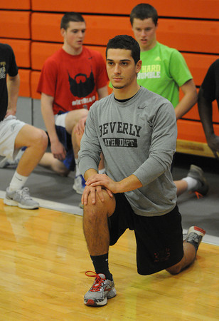 Beverly:<br /> Bruno Caetano stretches during practice on the first day of boys indoor track.<br />  Photo by Ken Yuszkus / The Salem News, Monday, December 2, 2013.