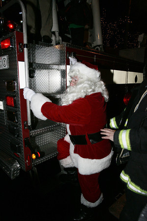 Salem:<br /> Santa touches ground after descending from the roof of the Hawthorne Hotel by the fire department's ladder.<br /> Photo by Ken Yuszkus/The Salem News, Friday, December 7, 2012.
