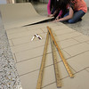 "Salem:<br /> Abby Carino, left, and Sophia Kapoglis, both 6th graders, tape together rolls of cardboard which will be a boardwalk for the Collins Middle School's ""a night at the beach"" fundraiser <br /> Photo by Ken Yuszkus/The Salem News, Monday, December 3, 2012."