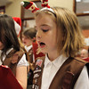 Brownie Scout Kelly Lovett, of St. John's Peabody sports a festive holiday headband as she sings Christmas Carols to residents gathered at the Towne Center at Brooksby Village on Wednesday afternoon. David Le/Staff Photo