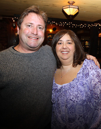 Phil and Stacey Padulsky, of Marblehead, at the Salem Children's Charity Christmas Party at Victoria's Station in Salem. David Le/Staff Photo