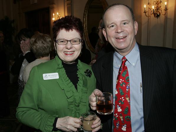 Salem:<br /> Julie Lederhaus of the Hawthorne Hotel, left, and Tom Dexter of Wells Fargo, attend the Salem Chamber annual holiday breakfast held at the Hawthorne Hotel.<br /> Photo by Ken Yuszkus/The Salem News, Thursday, December 13, 2012.