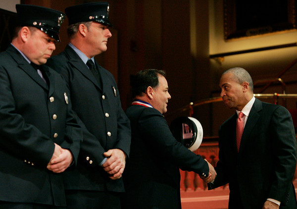 Worcester:<br /> Salem firefighters, Randy Theriault, Michael O'Donnell stand with Lt. Richard Arno who shook  Governor Deval Patrick's hand after receiving the medal of honor which they all received on stage at Mechanic's Hall.<br /> Photo by Ken Yuszkus/The Salem News, Tuesday, December 18, 2012.