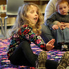"Maura Shinnick, 4 1/2, of Salem, sings along to ""Frosty the Snowman"" at a Holiday Sing-a-long at Peabody Public Library on Saturday morning. David Le/Staff Photo"