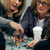 Salem:<br /> Carol Leahy, left, and Claire Bolger work together on their group's legos project during a teambuilding exercise at the Enterprise Center.<br /> Photo by Ken Yuszkus/The Salem News, Tuesday, December 4, 2012.