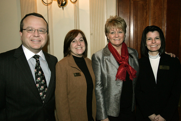 Salem:<br /> From left, David Surface, Kathy MacDonald, Kathy Donahue, and Amy Delaney, all of St. Jean's Credit Union, attend the Salem Chamber annual holiday breakfast held at the Hawthorne Hotel.<br /> Photo by Ken Yuszkus/The Salem News, Thursday, December 13, 2012.