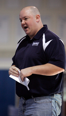 Danvers:<br /> Peabody's head wrestling coach Dave Pinette calls out instructions to his wrestler during a match at the St. John's Prep wrestling quad-meet.<br /> Photo by Ken Yuszkus/The Salem News, Monday, December 24, 2012.