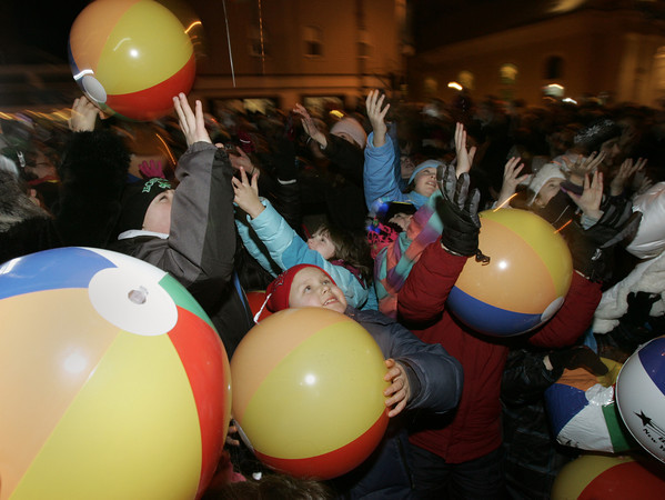 Beverly:<br /> Children reach for beach balls which were thrown out second story windows and from the ground during the Kid's Countdown on Cabot Street at Beverly's New Year.<br /> Photo by Ken Yuszkus/The Salem News, Monday, December 31, 2012.