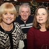 From left, Pam Camarda, of Beverly, and Rich and Kathy Hutchinson, also of Beverly, at the Salem Children's Charity Christmas Party at Victoria's Station in Salem. David Le/Staff Photo