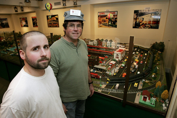 Wenham:<br /> Eric Flanagan, left, and his father Rob Flanagan stand with one of their train setups in the background at the Wenham Museum.<br /> Photo by Ken Yuszkus/The Salem News, Friday, December 21, 2012.