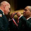 Worcester:<br /> Peabody fire department's Deputy Chief Eric Harrison receives the medal of honor from Governor Deval Patrick's on stage at Mechanic's Hall.<br /> Photo by Ken Yuszkus/The Salem News, Tuesday, December 18, 2012.
