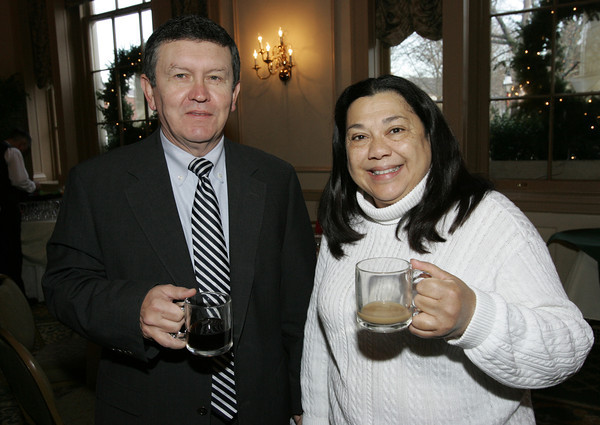 Salem:<br /> Jim Griffiths, left, and Betty Lopes, both of Ryan and Coscia, attend the Salem Chamber annual holiday breakfast held at the Hawthorne Hotel.<br /> Photo by Ken Yuszkus/The Salem News, Thursday, December 13, 2012.