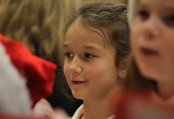 McKenzie Fure, a Brownie Scout from St. John's Peabody sings Christmas Carols at Brooksby Village for residents on Wednesday afternoon. David Le/Staff Photo