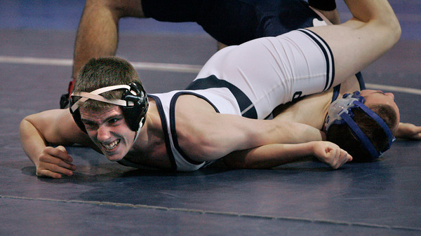Danvers:<br /> St. John's Prep's Jared Costa, left, holds down Peabody's Tom Fraser for a pin at the St. John's Prep wrestling quad-meet. Costa won the match in the 138 weight class.  .<br /> Photo by Ken Yuszkus/The Salem News, Monday, December 24, 2012.