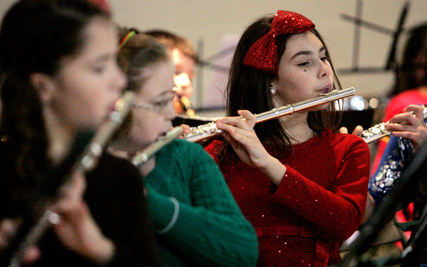 Danvers:<br /> Sarina Stempien plays the flute  during the Great Oak School winter concert.<br /> Photo by Ken Yuszkus/The Salem News, Wednesday, December 19, 2012.