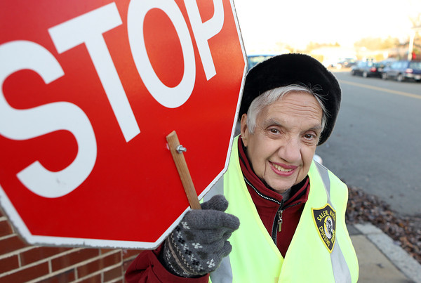 Rita French, 84, a crossing guard at the corner of Webb and Essex Streets in Salem, near the Bentley School, will be retiring next week after working for 13 years as a crossing guard in the City of Salem. David Le/Staff Photo