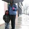 Beverly:<br /> Joy Sturrup and her son Dontae, who is wearing a Spiderman mask, walk in the rain on Cabot Street in Beverly.<br /> Photo by Ken Yuszkus/The Salem News, Monday, December 17, 2012.