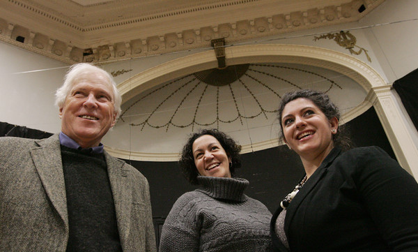 Salem:<br /> From left, Sandy Dixon, president of the board of Historic, Inc., Mari Matt, executive director of the Salem YMCA, and Nicole Leotsakos, performing Arts director, are in Ames Hall which they are raising more than $1 million to restore.<br /> Photo by Ken Yuszkus/The Salem News, Friday, December 14, 2012.