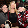 From left, Beth Tobin, of Salem, Suzanne Russo, of Lynn, and Malia Griffin of Salem, at the Salem Children's Charity Christmas Party at Victoria's Station in Salem. David Le/Staff Photo