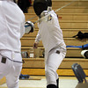 St. John's Prep fencer Dan Howlett sparrs with his opponent on Thursday evening against Concord-Carlisle. David Le/Staff Photo