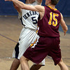 Hamilton:<br /> Hamilton-Wenham's Ben Kozlowski, left, is covered by Newburyport's Adam Traxler during the Newburyport at Hamilton-Wenham boysbasketball game.<br /> Photo by Ken Yuszkus/The Salem News, Friday, December 21, 2012.