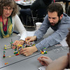 Salem:<br /> Peggy Hothem, left, and Bradley Backer work with legos during a teambuilding exercise at the Enterprise Center.<br /> Photo by Ken Yuszkus/The Salem News, Tuesday, December 4, 2012.