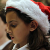 Brownie Scout Amelia Silvestro, of St. John's Peabody sings Christmas Carols to residents gathered at the Towne Center at Brooksby Village on Wednesday afternoon. David Le/Staff Photo