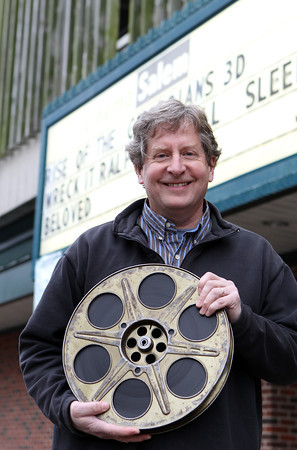 Paul Van Ness, co-owner of CinemaSalem, will try to raise $60,000 by January 14, 2013 in order to implement a Kick Starter system that will help convert the theater from showing 35mm films, to digital projection films. Movie distributers will stop sending out 35mm films later on in 2013, but Van Ness and CinemaSalem will be replacing their 35mm film with the digital projections before then. David Le/Staff Photo