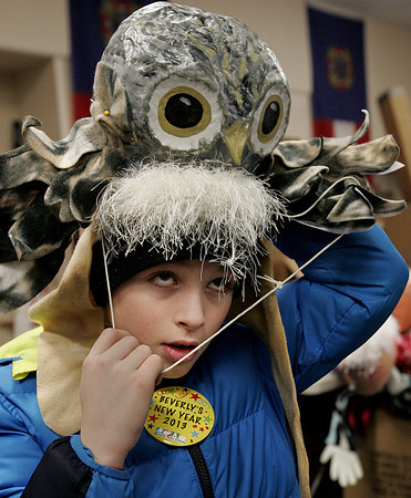 Beverly:<br /> Nick Gribbins, 9, of Beverly, picks out his costume to wear in the Grand Procession at Beverly's New Year.<br /> Photo by Ken Yuszkus/The Salem News, Monday, December 31, 2012.