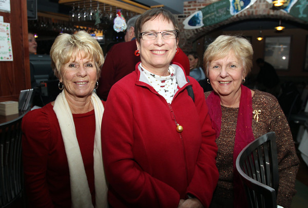 From left, Judy Ingemi, of Salem, Anne Devoe, of Salem, and Barbara Robinson, of Peabody, at the Salem Children's Charity Christmas Party at Victoria's Station in Salem. David Le/Staff Photo