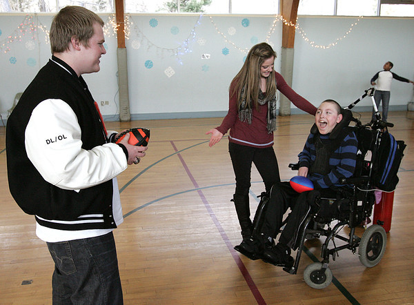 Danvers:<br /> Beverly football player Kevin Kennedy, left, speaks through interpreter Desiree Weems, center, to Beverly School for the Deaf student Max Plansky.<br /> Photo by Ken Yuszkus/The Salem News, Thursday, December 20, 2012.