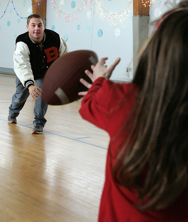 Danvers:<br /> Beverly football player Marc Babcock, left, plays catch with Beverly School for the Deaf student Brenda Lavoie.<br /> Photo by Ken Yuszkus/The Salem News, Thursday, December 20, 2012.