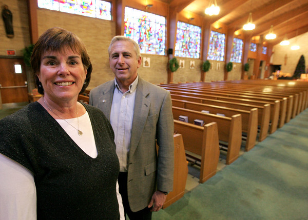 Danvers:<br /> Betsy Geheb, chairman for the 50th, and John Call, parish council, are in St. Richard Parish in Danvers which celebrates it's 50th anniversary.<br /> Photo by Ken Yuszkus/The Salem News, Friday, December 21, 2012.