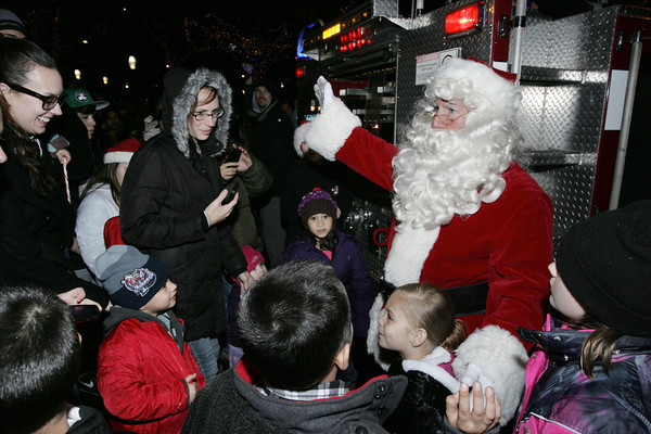 Salem:<br /> Santa greets the crowd assembled to meet him.<br /> Photo by Ken Yuszkus/The Salem News, Friday, December 7, 2012.