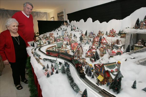 Peabody:<br /> Joan Pappalardo and John Murphy built a North Pole village display.<br /> Photo by Ken Yuszkus/The Salem News, Friday, December 7, 2012.