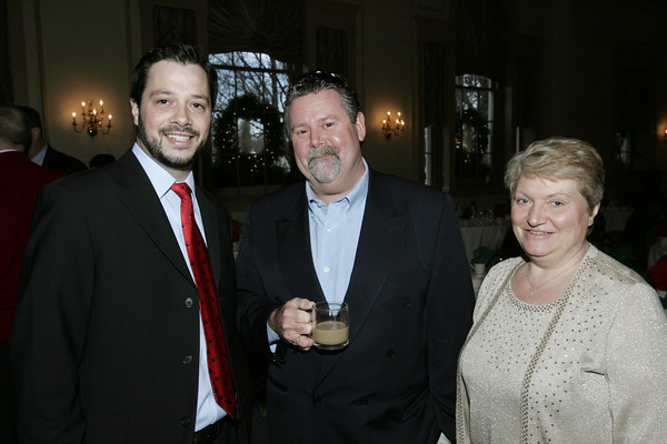Salem:<br /> From left, Ben Bouchard of RCG, Leighton Connor of Blue Swirl.Com, and Anna Kulakowski of East Boston Savings Bank, attend the Salem Chamber annual holiday breakfast held at the Hawthorne Hotel.<br /> Photo by Ken Yuszkus/The Salem News, Thursday, December 13, 2012.