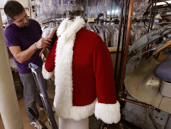 Beverly:<br /> Bruce Nadeau, owner of Hallmark Cleaners and Shirt Launderers, preps a Santa jacket for a patron to use in the upcoming holiday season.<br /> Photo by Ken Yuszkus/The Salem News, Wednesday, December 5, 2012.
