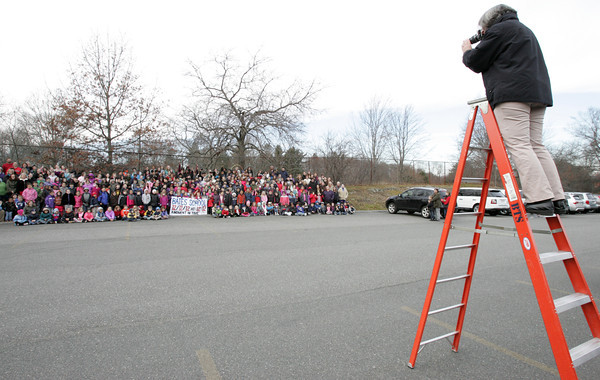 Salem:<br /> Terry Mullen, photographer for Life Touch, photographs the students at Bates School at 12:12 PM.<br /> Photo by Ken Yuszkus/The Salem News, Wednesday, December 12, 2012.